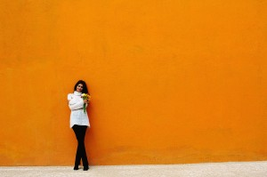 Woman Against Orange Wall
