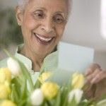 Senior Woman Receiving Tulip Bouquet